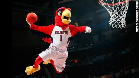 ATLANTA, GA - JANUARY 28:  Harry the Hawk, mascot of the Atlanta Hawks, dunks during a timeout in the game between the Atlanta Hawks and the Brooklyn Nets at Philips Arena on January 28, 2015 in Atlanta, Georgia.  NOTE TO USER: User expressly acknowledges and agrees that, by downloading and or using this photograph, User is consenting to the terms and conditions of the Getty Images License Agreement.  (Photo by Kevin C. Cox/Getty Images)