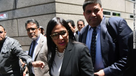 Venezuela's Foreign Minister Delcy Rodriguez (C), arrives to the Argentine Foreign Ministry in Buenos Aires during a meeting among Mercosur's ministers where Venezuela was not invited, on December 14, 2016. Mercosur's foreign ministers debate on Venezuela's suspension from the group after accusations that the leftist government in Caracas failed to meet democratic and trade standards. / AFP / EITAN ABRAMOVICH        (Photo credit should read EITAN ABRAMOVICH/AFP/Getty Images)
