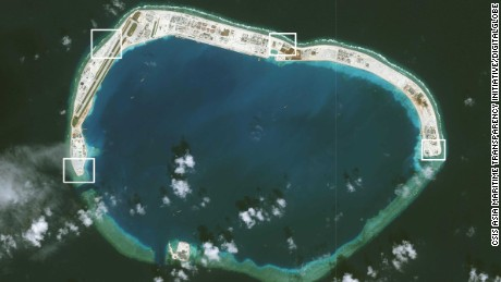 A satellite image of Mischief Reef showing military installations.