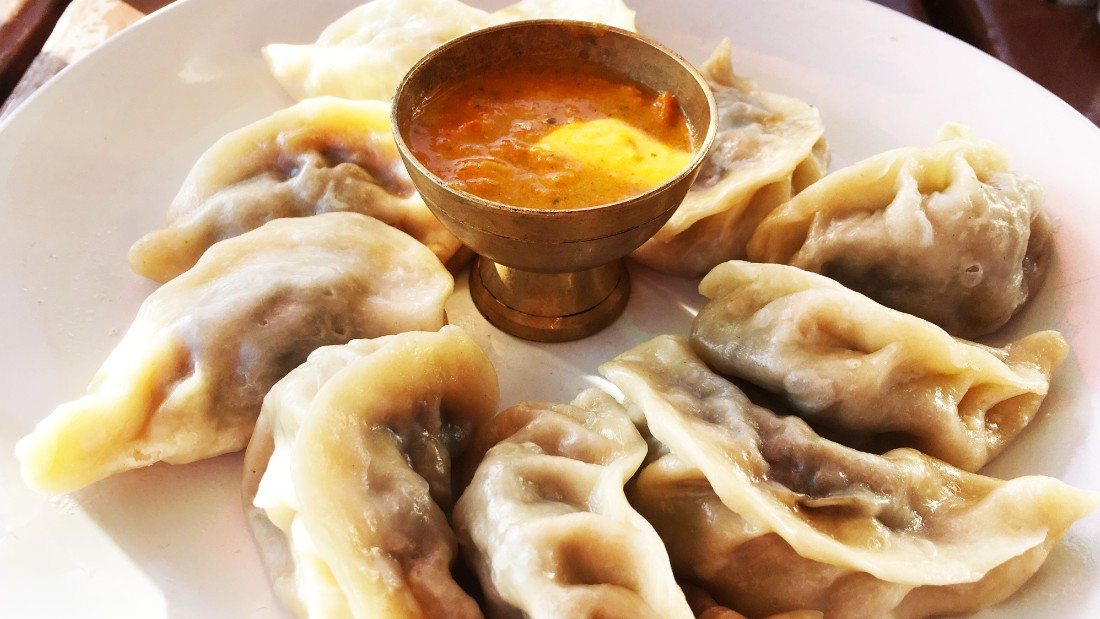 These momos are served with a curry-based sauce.