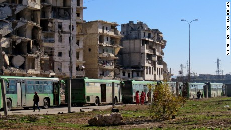 Buses used to evacuate rebel fighters and their families from rebel-held areas of Aleppo are seen waiting on Thursday.