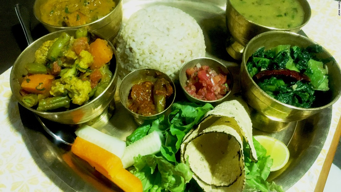 Presentation is everything in Nepalese cuisine: here dal bhat is served with the usual trappings on a metal tray. Nepalese food is typically lighter than Indian cuisine, with leaner curries that are tomato- rather than cream-based.