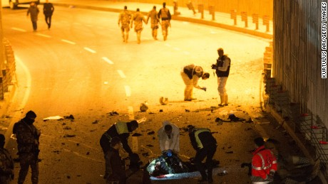 ISTANBUL, TURKEY - DECEMBER 10:  (EDITOR'S NOTE: Image contains graphic content) Forensic policemen and officers attend the scene following a twin suicide bomb attack near to  Besiktas Vodaphone Arena on December 10, 2016 in Istanbul, Turkey. According to reports, at least 13 people were killed by a twin suicide bomb attack near to the Besiktas Vodaphone Arena, which is believed to have been targeting riot police. (Photo by Kurtulus Ari /Getty Images)