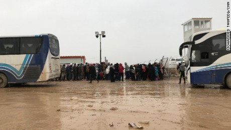 Buses take refugees to the camp, just 20km outside of the city.