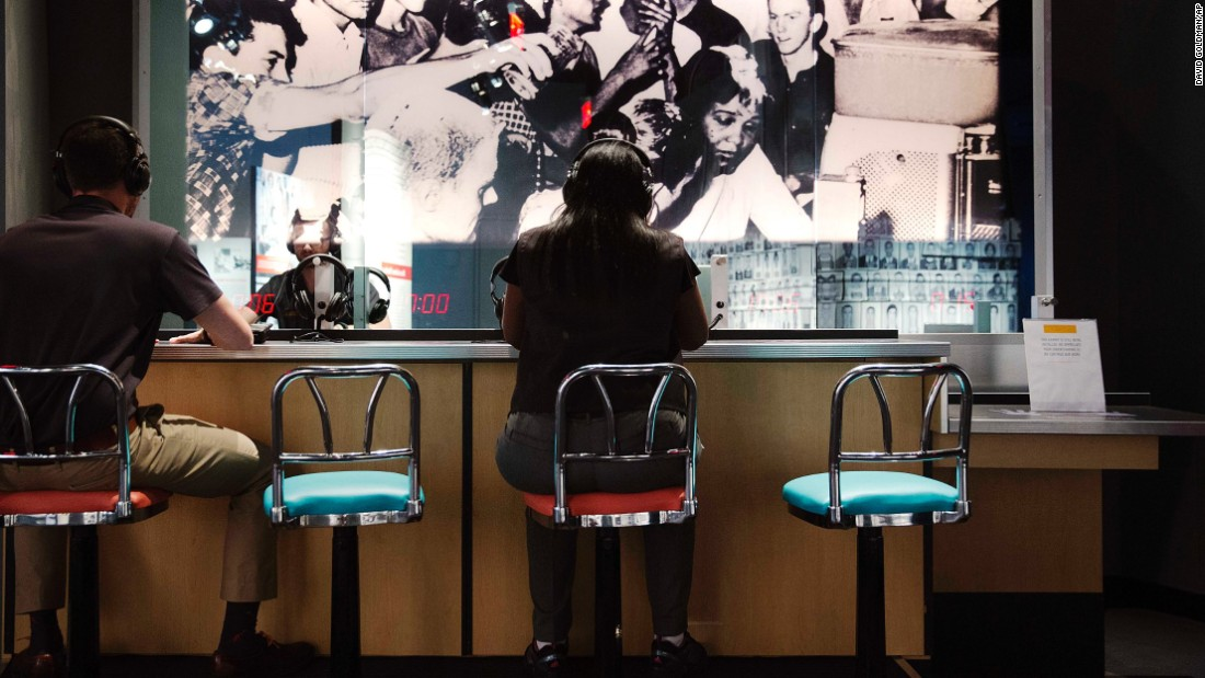 "The past is connected to the present at the Center for Civil and Human Rights, where visitors can listen through headphones to increasingly intense taunts and threats endured by protesters during staged sit-ins at ""whites only"" dining counters in the 1960s."