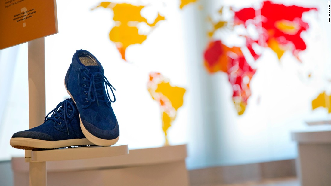 One exhibit at the Center for Civil and Human Rights explores the ethical footprint of sneakers, chocolate soccer balls, flowers and other common consumer products that are sometimes connected to child labor and other unfair labor practices.