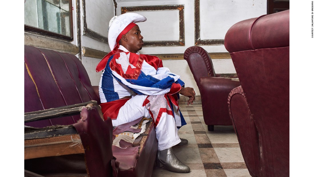A performer from the Los Componedores de Batea lounges after a show at the Casa de la Musica in Havana.