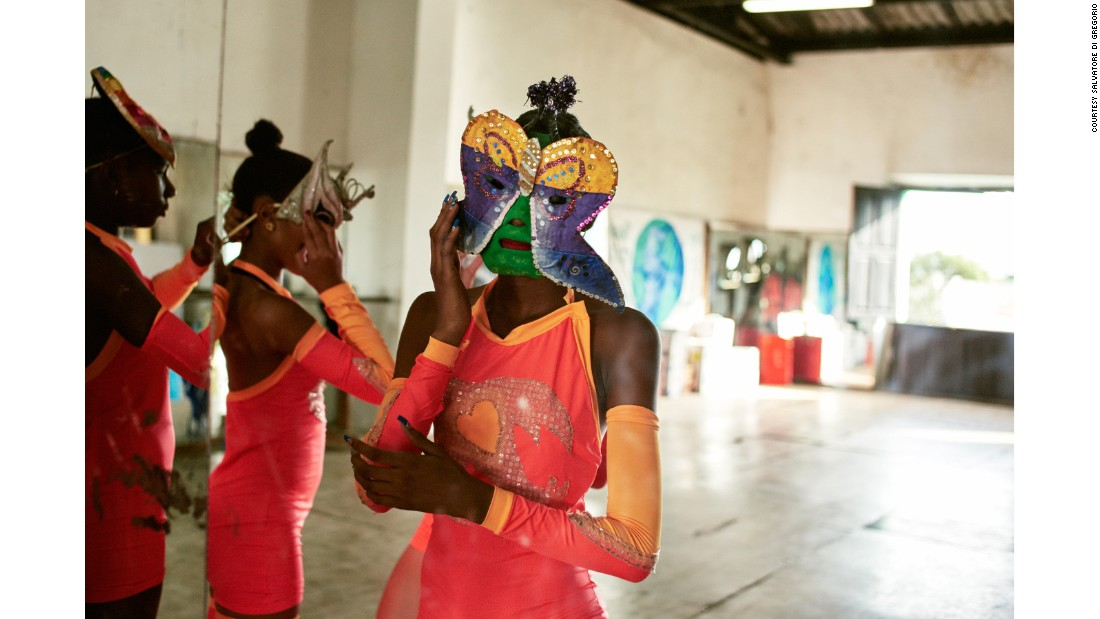 "In ""Las Comparsas de Cuba,"" fashion photographer Salvatore di Gregorio's intimate portraits show another side of Cuba's carnival dancers. Here, teenaged dancers prepare for a dress rehearsal at La Casa de la Musica in the city of Matanzas."