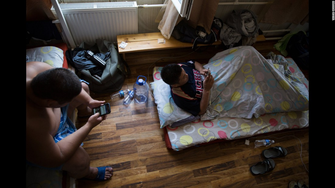 "Wrestlers hang out in their dorm after a practice session in Mongolia. Japan has traditionally dominated the sport, and it's only in the past decade that Mongolia has emerged as such a dominant force. The past four ""yokozuna,"" sumo wrestling's highest rank, have all been from Mongolia."