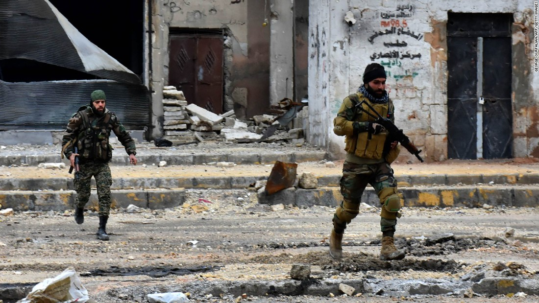 Pro-government forces advance in Aleppo on Wednesday, December 14.