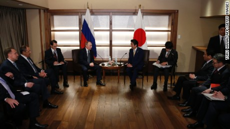 Russian President Vladimir Putin talks with Japanese Prime Minister Shinzo Abe at the start of their summit meeting in Nagato, Yamaguchi prefecture on December 15.