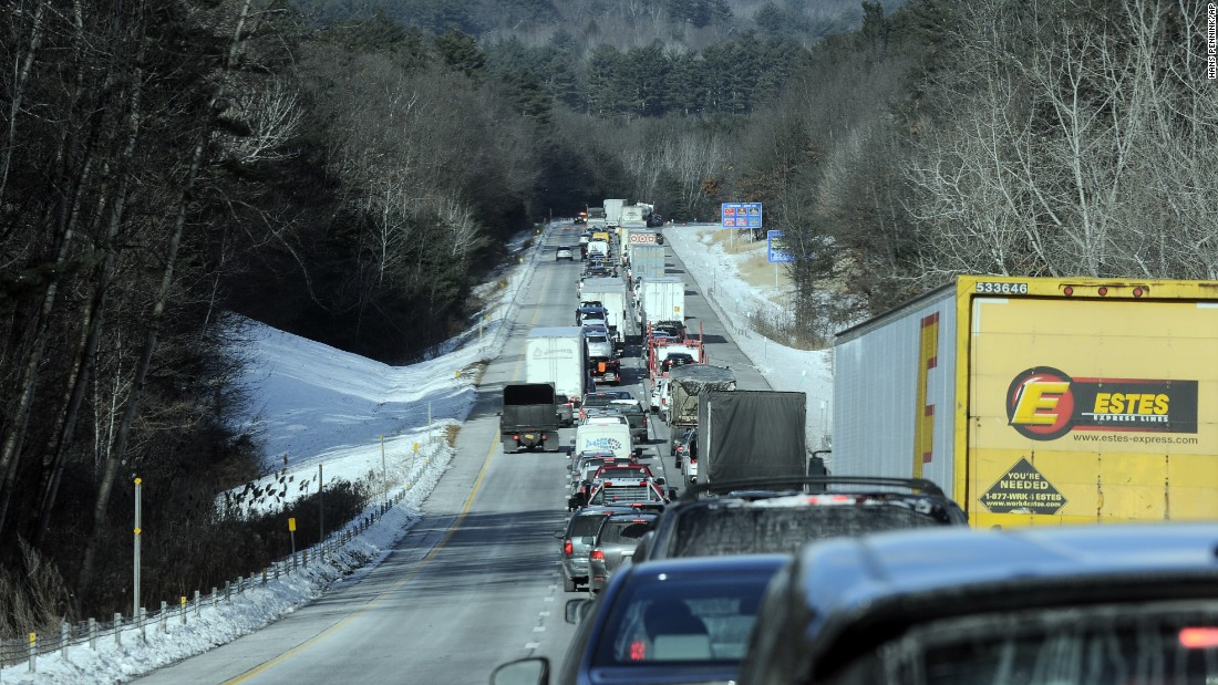 Motorists wait December 15 as crews remove a tractor-trailer from an accident scene involving a New York state Department of Transportation snow plow from the northbound lane of the I-87 Adirondack Northway in Queensbury.