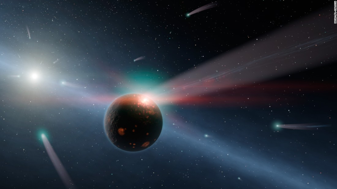 "What would a storm of comets around a star look like? Hurt's illustration of <a href=""http://www.spitzer.caltech.edu/images/4772-ssc2011-08a-It-s-Raining-Comets"" target=""_blank"">Eta Corvi</a> shows how comets are torn to shreds after colliding with a rocky body."