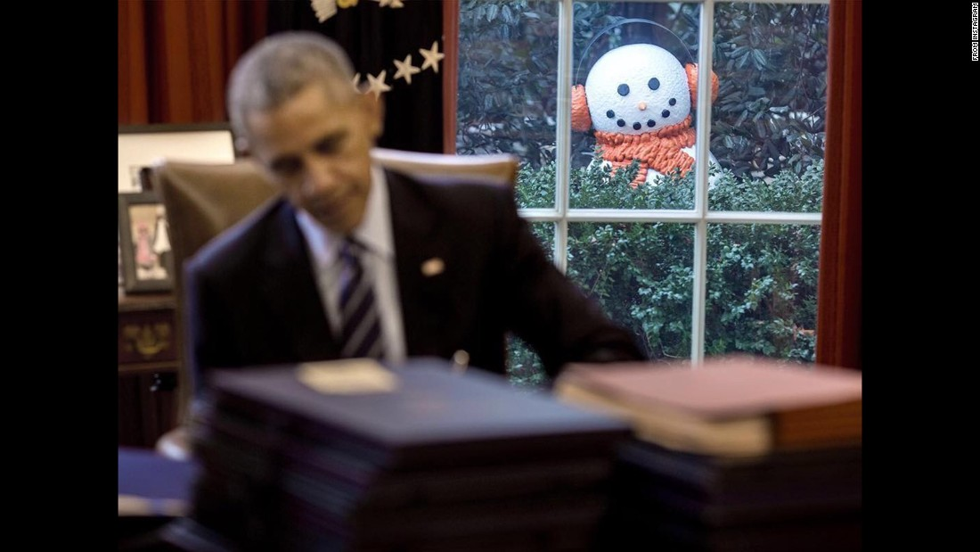 "A snowman peeks through an Oval Office window in this photo <a href=""https://www.instagram.com/p/BOF_jkGDWke/"" target=""_blank"">posted to Instagram</a> by official White House photographer Pete Souza. ""For the past three weeks, there have been four snowmen on display in the Rose Garden,"" Souza said in his post on Friday, December 16. ""We've been joking that we should move the snowmen a few feet closer to the Oval Office every day to see if anyone noticed."""