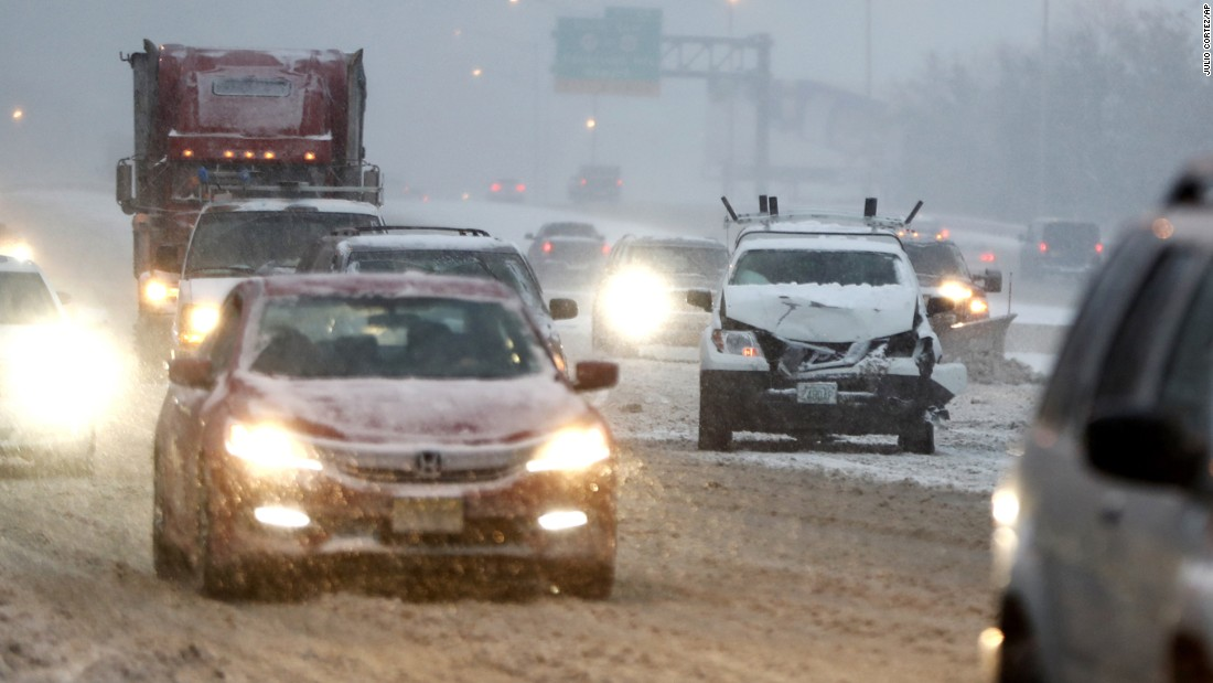 A vehicle involved in a crash sits on Interstate 80 during a snowfall December 17 in Lodi, New Jersey.