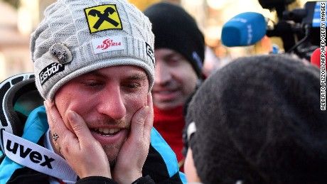 Austria's Max Franz is congratulated by his girlfriend after winning the downhill at Val Gardena.
