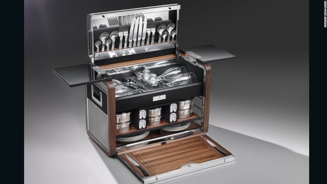 "Rolls-Royce's 12-piece <a href=""https://www.rolls-roycemotorcars.com/en-GB/ownership/picnic-hamper.html"" target=""_blank"">picnic hamper</a> is made from a decadent mixture of saddle leather, polished aluminum and oiled teak, while the wine glasses are created using a glass-blowing technique that's more than 200 years old."
