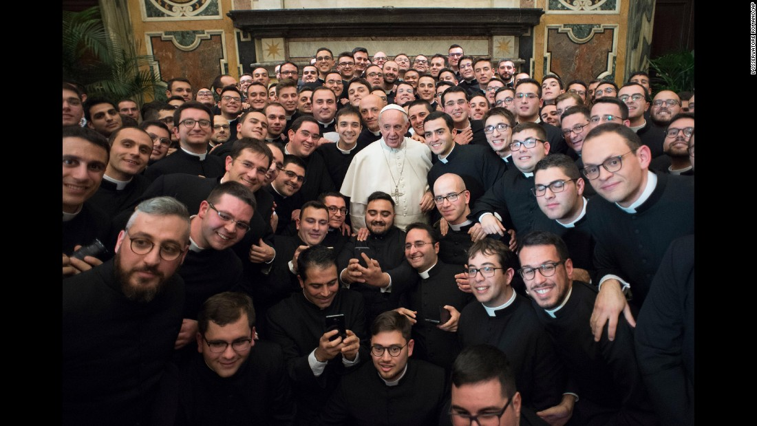 Pope Francis poses with members of the International Catholic Rural Association at the Vatican on Saturday, December 10.