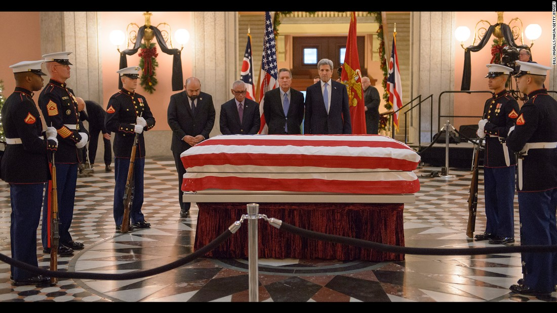 "US Marines and several public officials -- from left, Ohio House Speaker Cliff Rosenberger, NASA Administrator Charles Bolden, Ohio Gov. John Kasich and US Secretary of State John Kerry--  pay their respects to former astronaut and US Sen. John Glenn as he lies in repose at the Ohio Statehouse on Friday, December 16. Glenn, the first American to orbit the Earth, <a href=""http://www.cnn.com/2016/12/08/health/john-glenn-dead/"" target=""_blank"">died last week</a> at the age of 95."