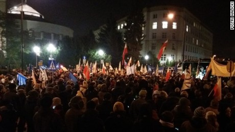 Warsaw residents joined in a protest in front of Poland's parliament building Friday against a plan by the conservative ruling party to limit reporters' access to legislators.
