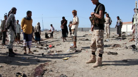 Yemenis gather at al-Sawlaba base in Aden's al-Arish district  after a suicide bomber targeted a crowd of soldiers.