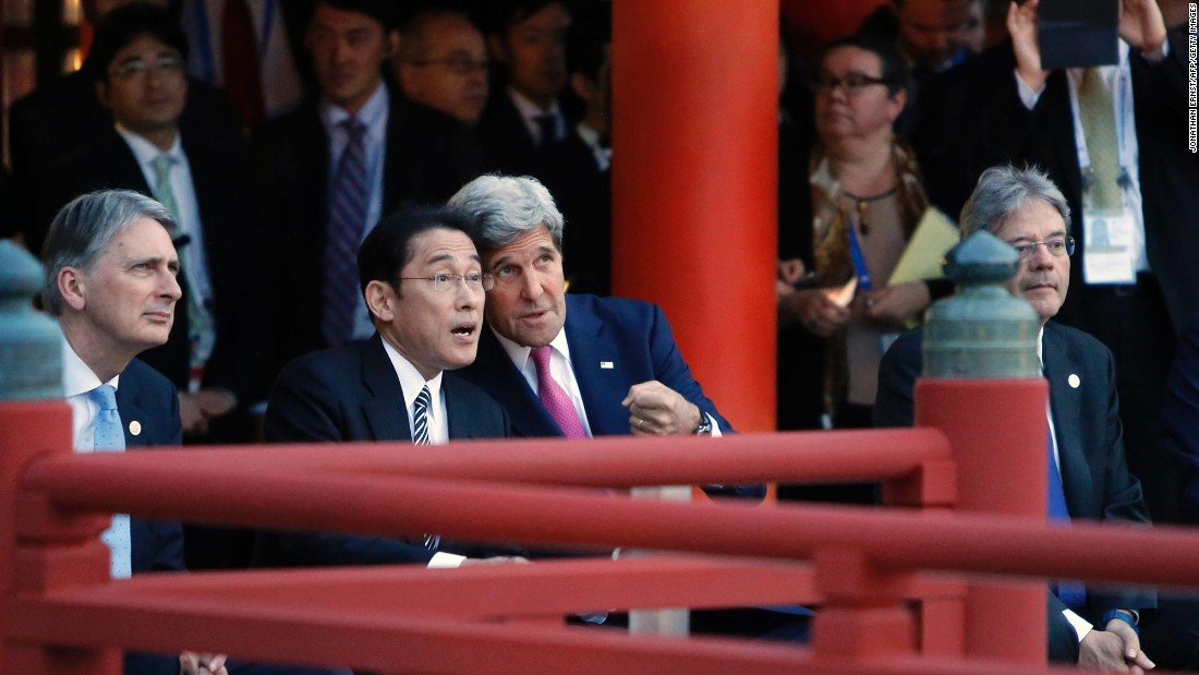 Kerry talks to Japan's foreign minister, Fumio Kishida, during a ceremonial dance at the Itsukushima Shrine on April 10, 2016. They joined Britain's foreign minister, Philip Hammond, left, and Italy's foreign minister, Paolo Gentiloni, right, in a  visit Japan's Miyajima Island during a break in G7 meetings in nearby Hiroshima.