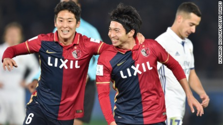 Kashima Antlers midfielder Gaku Shibasaki (right) celebrates his second goal as his side took a shock 2-1 lead against Real Madrid.