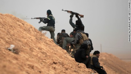 Shiite fighters from the Hashed al-Shaabi (Popular Mobilisation) paramilitary units advance towards the village of Shwah, south of the city of Tal Afar on the western outskirts of Mosul, on December 13, 2016, during an ongoing operation against Islamic State (IS) group jihadists.Hashed al-Shaabi paramilitary forces said they retook three more villages southwest of Mosul, completing another phase in operations aimed at cutting the jihadists' link to Syria. / AFP / AHMAD AL-RUBAYE        (Photo credit should read AHMAD AL-RUBAYE/AFP/Getty Images)