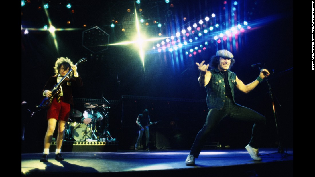 "This mostly Australian band survived the tragic death of popular lead singer Bon Scott and went on to record some of their best work. AC/DC is led by Aussie Angus Young, left, on guitar. Angus' brother -- rhythm guitarist Malcolm Young -- left the band for health reasons in 2014. Englishman Brian Johnson, right, took over lead singing duties from Scott in 1980 and stepped away from the band for health reasons in 2016. Well-known AC/DC songs include: ""Highway to Hell,"" ""You Shook Me All Night Long"" and ""Thunderstruck."" The band has sold 72 million units in the US, according to the Recording Industry Association of America."