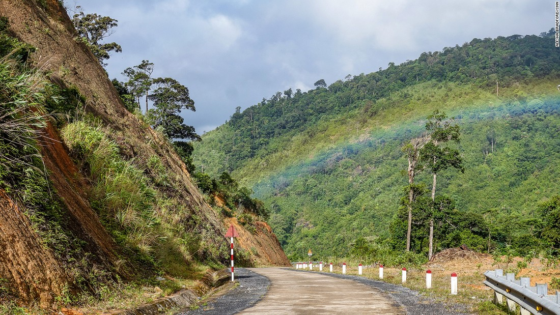 A rainbow appears over the Western Ho Chi Minh Highway during a break in the rain. This remote section of road has become something of a legend for motorcyclists traversing the length of Vietnam.