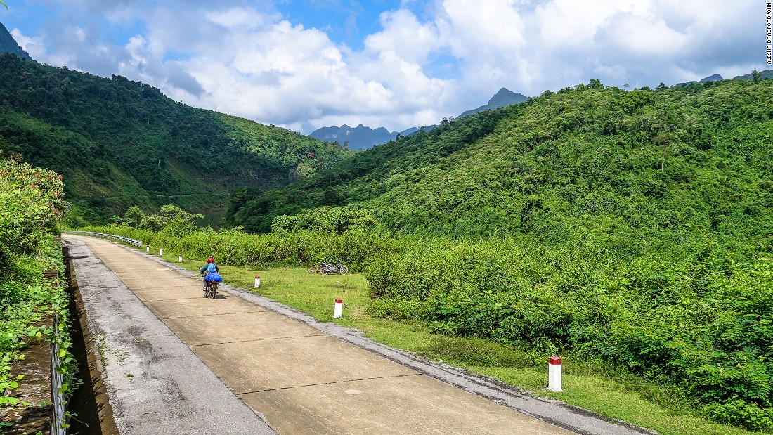 The author rides through jungled terrain along the Western Ho Chi Minh Highway.