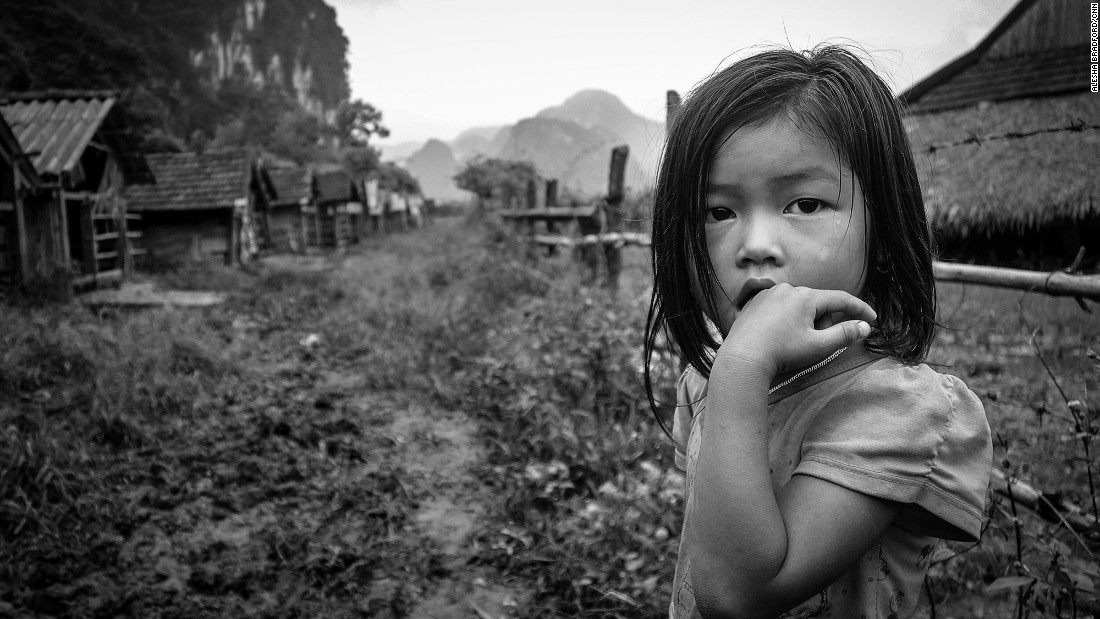 "Riding a motorbike allows you to visit tiny villages that public buses can't get to. While it's foolish to believe you are the ""first foreigner"" a person has ever seen, it's not uncommon to spend time with villagers that have rarely connected with an international visitor before, such as this intensely curious young girl in Tan Hoa village."