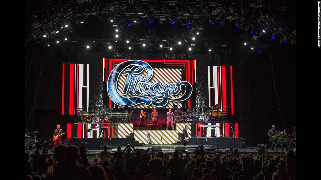 "In 1967, musician friends in Chicago formed a band that would eventually go on for half a century. Chicago Transit Authority shortened their name to Chicago and created a string of hit records that would dominate Top 40 radio through the 1970s and '80s, with songs like ""25 or 6 to 4,"" ""Just You and Me,"" ""If You Leave Me Now"" and ""Hard to Say I'm Sorry.""  Shown here at a 2015 concert in Concord, California, the band has sold 38.5 million units in the US, according to the Recording Industry Association of America."