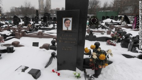 Pictured: The tombstone of Sergei Magnitsky in Moscow. The Russian lawyer uncovered the largest tax fraud in the country's history. He died in 2009 after a year in a Moscow detention center, apparently beaten to death.