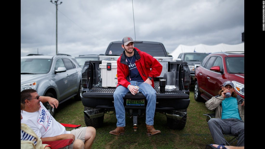 John Bonner, center, tailgates with friends outside the stadium before the rally.