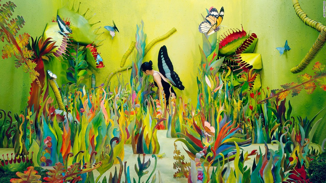 By giving herself a pair of butterfly's wings, the artist compared herself to a weak creature in the dangerous, jungle-like environment.