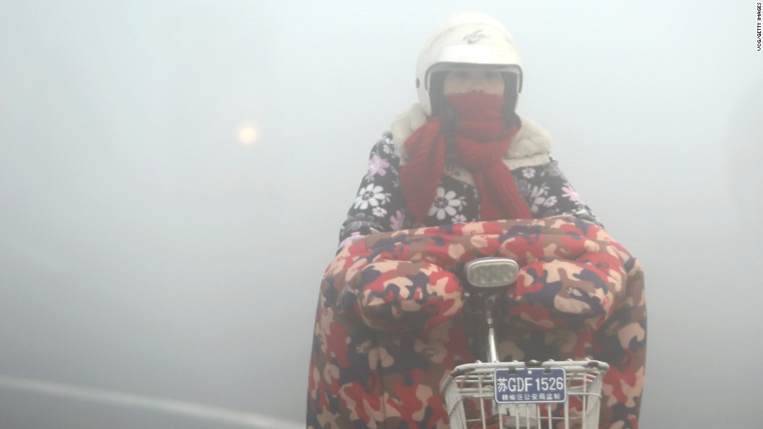 A cyclist rides in heavy smog in Lianyungang, China, on December 19.