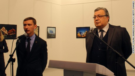 Andrey Karlov (R) was giving a speech during a visit to the Modern Art Center in Ankara, Turkey.