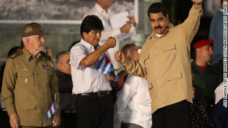 SANTIAGO DE CUBA, CUBA - DECEMBER 03:   President of Bolivia Evo Morales (L) greets Venezuela's President Nicolas Maduro at a memorial tribute for former President of Cuba Fidel Castro at the Antonio Maceo Revoloution Square before his burial tomorow on December 3, 2016 in Santiago de Cuba, Cuba. Mr. Castro died on November 25th at the age of 90 and the country is in the midst of a 9 day mourning period that lasts until his funeral on Sunday in Santiago de Cuba at the CementerioÊSanta Ifigenia.  (Photo by Joe Raedle/Getty Images)