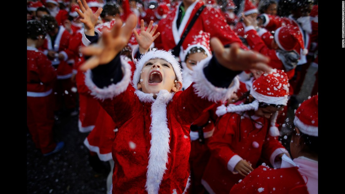 <strong>December 12:</strong> Children dressed as Santa Claus participate in a parade that collected food for the needy in Lisbon, Portugal.