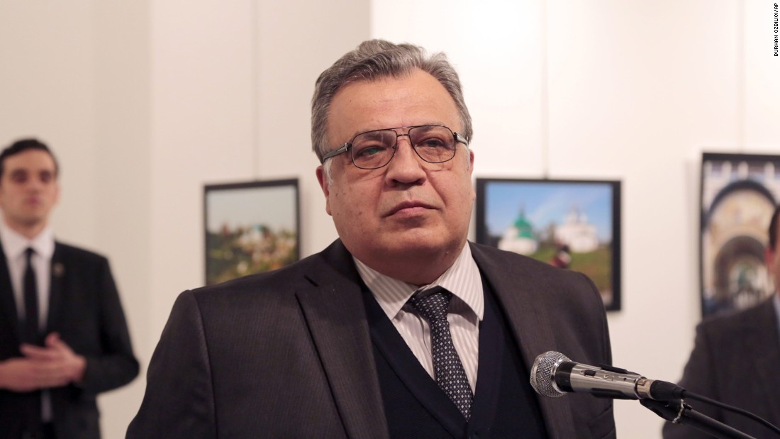 Andrey Karlov, the Russian ambassador to Turkey, speaks at the opening ceremony of a photo exhibit in Ankara, Turkey, on Monday, December 19. Moments later, he was fatally shot. Associated Press photographer Burhan Ozbilici was at the event and watched the assassination unfold.