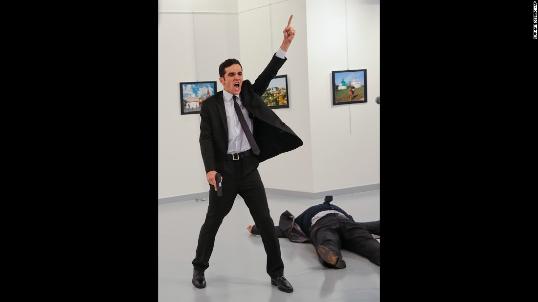 "<strong>December 19:</strong> A gunman gestures after <a href=""http://www.cnn.com/2016/12/19/middleeast/gallery/andrey-karlov-shooting/index.html"" target=""_blank"">assassinating Andrey Karlov,</a> the Russian ambassador to Turkey, at a photo exhibition in Ankara, Turkey. Turkish Interior Minister Suleyman Soylu said the gunman was Mevlut Mert Altintas, a Turkish police officer. In a video circulating on social media, the shooter was heard shouting, ""Allahu akbar (God is greatest). Do not forget Aleppo! Do not forget Syria! Do not forget Aleppo! Do not forget Syria!"" Russia is the most powerful ally of the Syrian regime and has carried out airstrikes since September 2015 to prop up embattled leader Bashar al-Assad. Karlov, 62, <a href=""http://www.cnn.com/2016/12/19/europe/who-was-andrey-karlov/"" target=""_blank"">had served in Ankara </a>since July 2013."