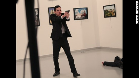 The gunman gestures shortly after Karlov was shot on December 19, 2016.