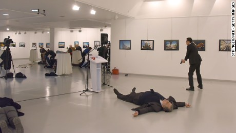 Graphic content / This picture taken on December 19, 2016 shows Andrey Karlov, the Russian ambassador to Ankara, lying on the floor after being shot by a gunman during an attack during a public event in Ankara.