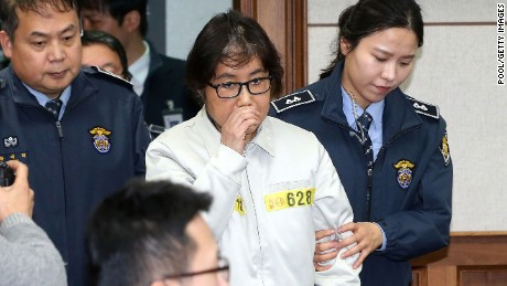 Choi Soon-Sil, the jailed confidante of disgraced South Korean President Park Geun-Hye, appears for the first day of her trial at the Seoul Central District Court on December 19.
