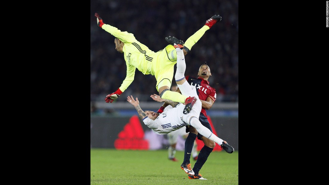 "Real Madrid goalkeeper Keylor Navas collides with teammate Sergio Ramos, bottom, and Kashima Antlers midfielder Fabricio during the final of the FIFA Club World Cup on Sunday, December 18. <a href=""http://www.cnn.com/2016/12/18/football/football-world-club-real-antlers-ronaldo/index.html"" target=""_blank"">Madrid won 4-2</a> in Yokohama, Japan."