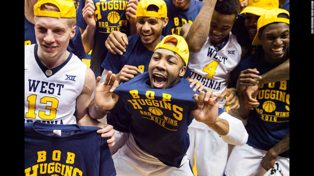 West Virginia basketball players celebrate a home victory against Missouri-Kansas City on Saturday, December 17. It was the 800th career victory for head coach Bob Huggins -- one of just 10 coaches to achieve the milestone.