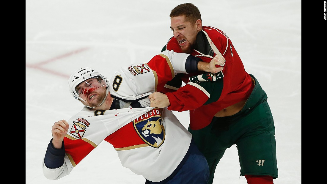 Florida's Dylan McIlrath, left, and Minnesota's Chris Stewart brawl during an NHL game in St. Paul, Minnesota, on Tuesday, December 13.
