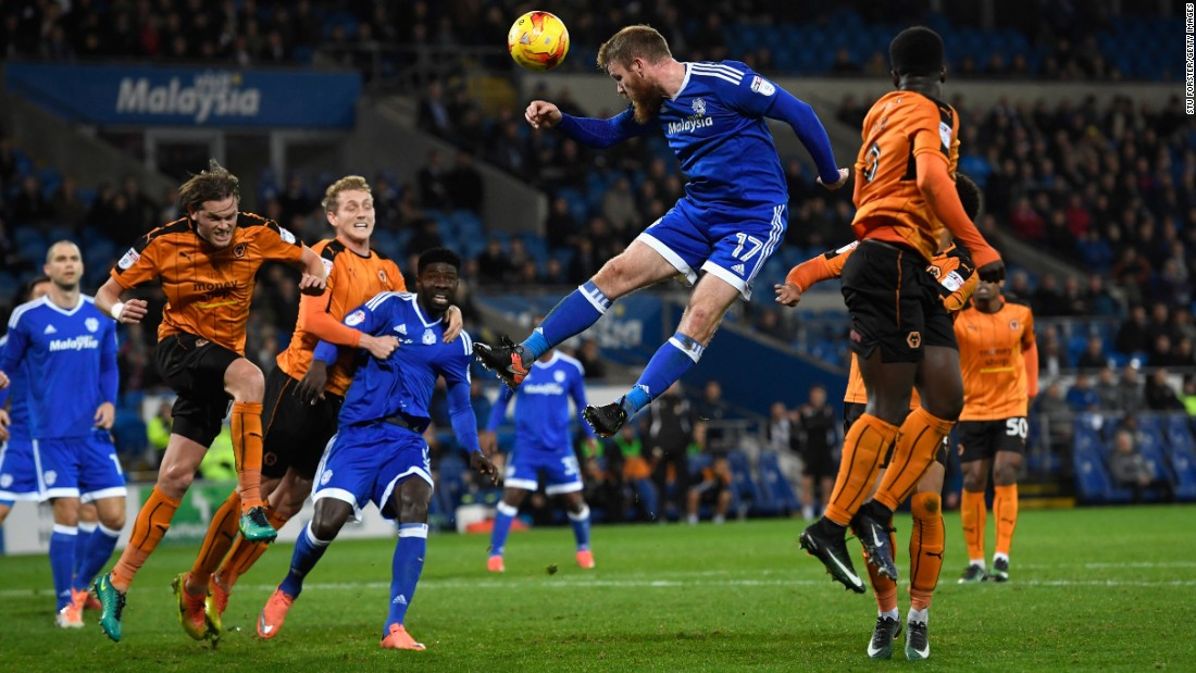 Cardiff City's Aron Gunnarsson meets a cross Tuesday, December 13, during a league match against Wolverhampton in Cardiff, Wales.