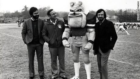 Tom Sapp, left, and his friend Mac Talmadge, far right, introduce Hairy Dawg to former University of Georgia head football coach Vince Dooley.